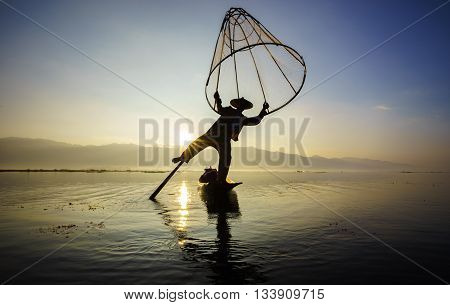 Fishermen in Inle Lake at sunrise Inle Shan State Myanmar