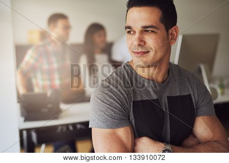 Calm Muscular Man In Office With Co-workers