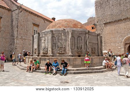 DUBROVNIK, CROATIA - JUNE 28, 2010: Unidentified tourists near the Big Fountain of Onofrio one of the old town, landmarks was build in 1444, Dubrovnik, Croatia