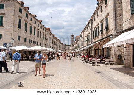 DUBROVNIK, CROATIA - JUNE13, 2010: Summer scene of the main street (Stradun or Placa) with locals and tourists in Dubrovnik, Croatia