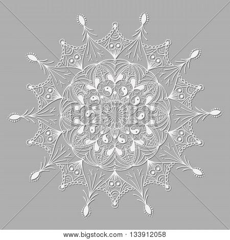 White mandala like lace with a sign of yin-yang