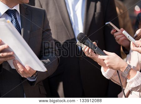 Journalists making media interview with businessperson or politician