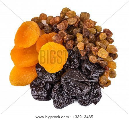 Heap Of Prunes, Driet Apricots And Raisins Isolated On White