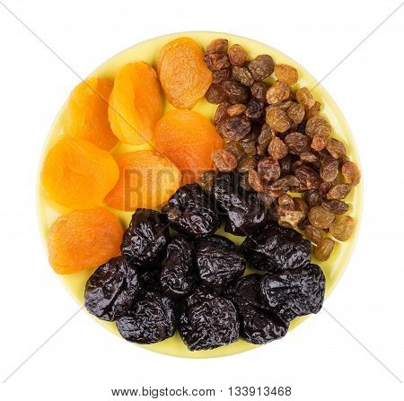Prunes, Driet Apricots And Raisins In Saucer Isolated On White