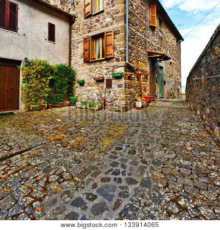 Narrow Alley with Old Buildings in Italian City of Torre Alfina