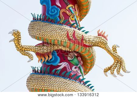 Twin golden claw of the dragon sculpture in the Chinese temple.