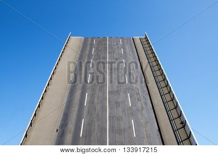Road leads directly upwards in the blue sky concept for future and success with copy space photo of the drawbridge in Luebeck Germany