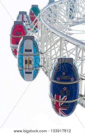 LONDON - OCTOBER 19 2015: Low angle view of some cabins of the famous London Eye ferris wheel one of the main tourist attractions in London