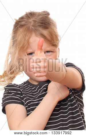 Portrait of a young girl with thumbs up on white background