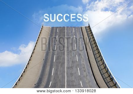 Road leads upwards in the blue sky with white clouds text SUCCESS business concept for future and new goals