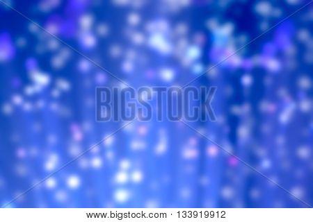 Abstract blur illuminated blue fiber optic light strands bokeh background
