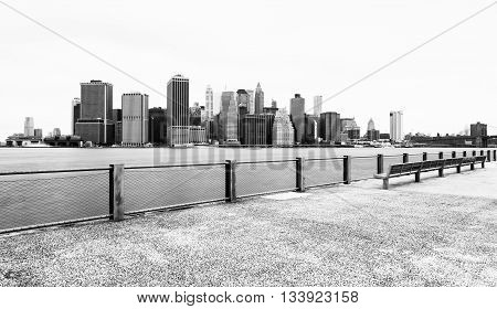 Manhattan skyline in cloudy day, black and white, view from Brooklyn Bridge Park, Pier 5, New York City, USA