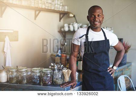 Handsome Black Entrepreneur Stands By Cafe Counter