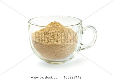 Flour sesame, cedar or oatmeal in a glass cup isolated on white background