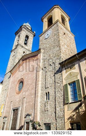 Piacenza February 21 2016: the two bell towers and the facade of the Bobbio's cathedral dome