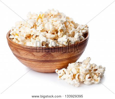 Popcorn in brown bowl on white background. Popcorn. Ceramic bowl full of popcorn studio isolated on white background