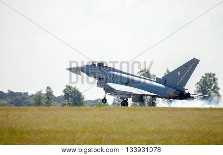 BERLIN / GERMANY - JUNE 3 2016: german eurofighter typhoon lands on airport schoenefeld berlin / germany at june 3 2016.