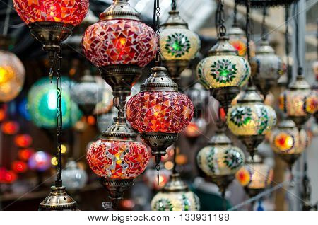 some glass lanterns exposed in a store