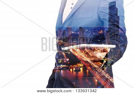 Double Exposure Image Of Businessman Use Digital Tablet And City Building At Twilight As Business Te