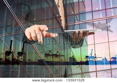 Double Exposure Of Businessman With Digital Tablet And Port Cargo And Airplane