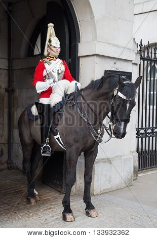 LONDON - APRIL 16: Unidentified men members of the royal guard nearby Whitehall palace on April 16, 2016 in London, United Kingdom.