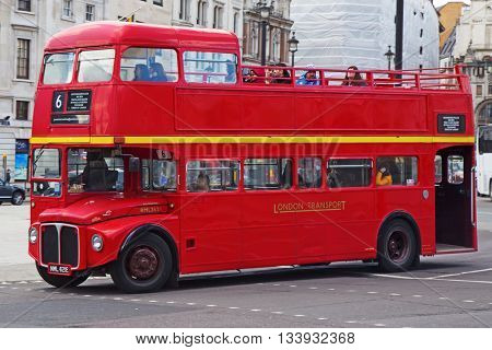 LONDON - APRIL 17: Red Double Decker Bus on the Canon street in London on April 17, 2016 in London, UK. These doubledecker bus is one of the most iconic symbols of London.