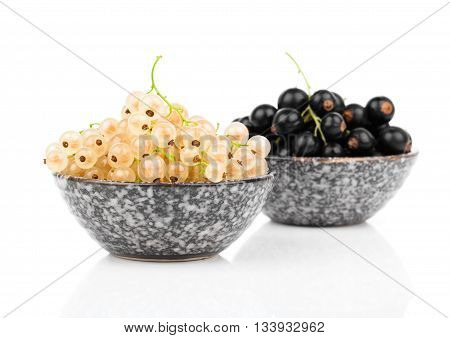 White currant fruit in a bowl isolated over white background.