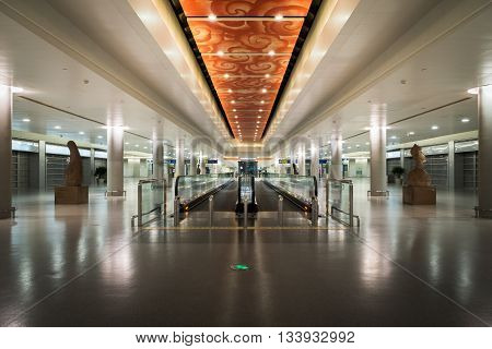 SHANGHAI, CHINA-circa June 2016: Modern airport interior and architecture in Shanghai Airport, China. Shanghai Pudong International Airport is the primary international airport serving Shanghai and a major aviation hub for Asia