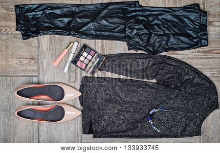Overhead view of female's fashion with accessories on wooden background