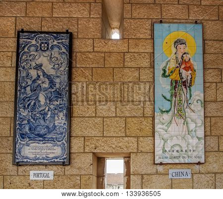 NAZARETH ISRAEL - MARCH 24: Panels of glazed tiles depicting the Virgin Mary and Angel Basilica of the Annunciation in Nazareth Israel on March 24 2016