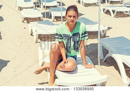 Girl Lounger And Beach