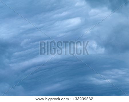 stormy blue-gray cumulus and cirrus clouds and the weather turned bad