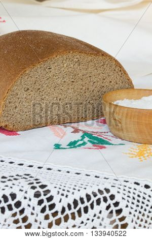 Bread is on a vintage towel with lace