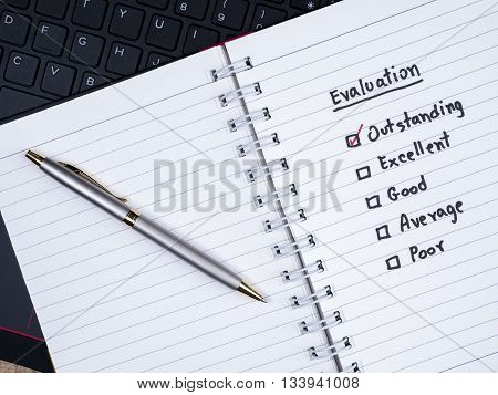 Handwriting Performance Evaluation check box on notebook with laptop keyboard