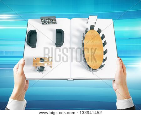 Businessman hands holding open book with abstract office interior on blue background. 3D Rendering