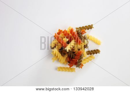 fusilli dry pasta on the white background