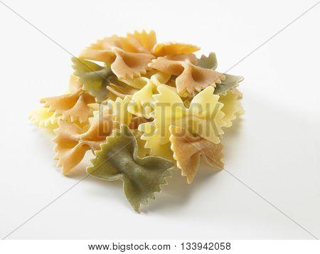 farfalle or farfalloni dry pasta on the white background