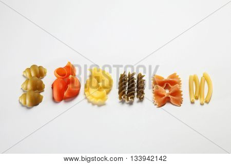 various dry pasta on the white background