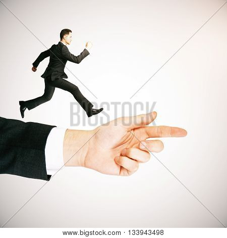 Guidance concept with businessman running on abstract arm pointing forward on light background