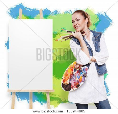 Happy artist. Woman artist with art tools. Female painter with brushes and palette. Empty canvas at easel at colorful wall with copy space. Fine art. Art classes for adults, education concept.