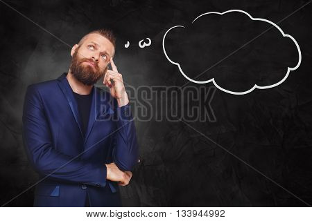 Man pensive with thinking cloud. Young man thoughtful. Caucasian man thinking at black gradient background. Serious stylish guy with beard consider some idea.