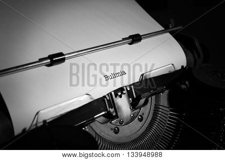 Old typewriter and inserted sheet of paper with medical report on bulimia
