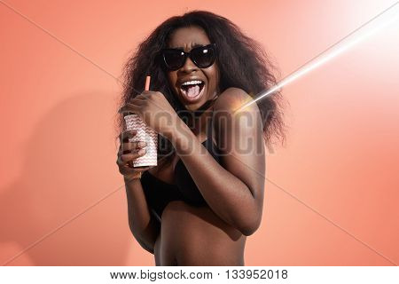 Woman Screaming Of Pain Of Sun Burning, Holding A Cocktail