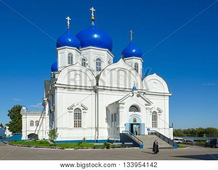 BOGOLUBOVO RUSSIA - AUGUST 21 2015: Unidentified people go to Cathedral of Bogolyubsk Icon of Our Lady of Holy Bogolyubsky monastery Vladimir region Russia