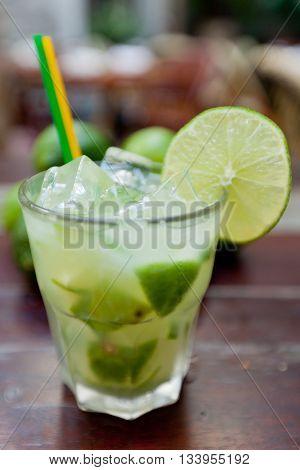 Caipirinha, a brazilian cocktail made of cachaça and lime on the table