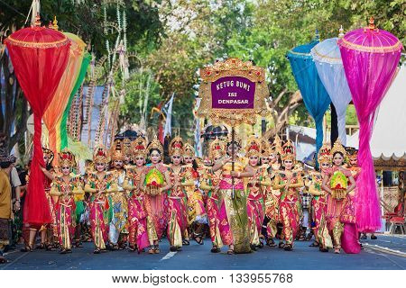 DENPASAR BALI ISLAND INDONESIA - JUNE 11 2016: Beautiful indonesian people group in colorful sarongs - traditional Balinese style ethnic dancer costumes at Bali Arts and Culture Festival parade