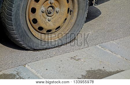 Old wheel of the car the tire defect