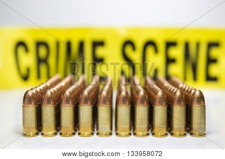 row of bullet with crime scene tape background