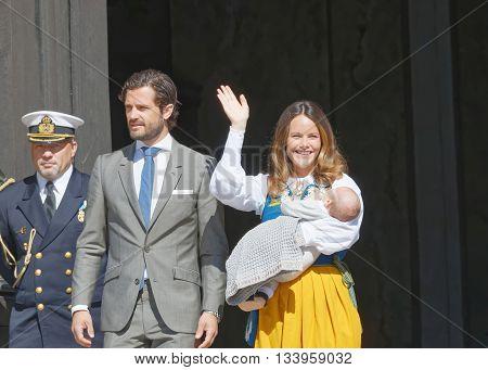 STOCKHOLM SWEDEN - JUN 06 2016: The swedish prins Carl Philip Bernadotte and princess Sofia Hellqvist waiving and holding the newborn baby Alexander