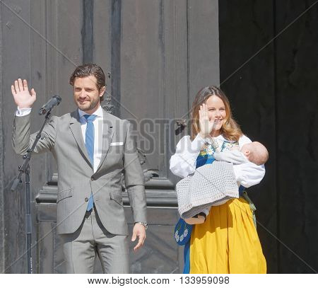 STOCKHOLM SWEDEN - JUN 06 2016: The swedish prins Carl Philip Bernadott and princess Sofia Hellqvist smiling and waiving to the audience holding the newborn baby Alexander